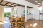Waiheke Como Bach: Dining kitchen area of beachfront bach Oneroa