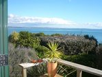 Waiheke Beach Barn: View from deck overlooking Rocky bay