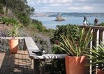 Waiheke Beach Barn: View from deck over Rocky Bay
